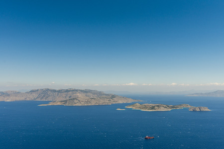 Aerial image of eastern Dodecanese Greek islands Koulondros, Seskli and Xisos in the Mediterranean Sea with Altera 1 LPG tanker in the foreground Stok Fotoğraf