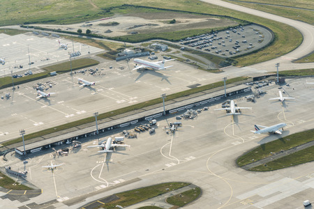 Aerial image of airplanes of Air France, Hop! and United Arab Emirates at Orly Ouest International airport Editorial
