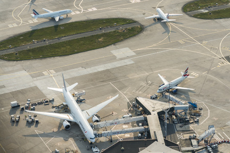 Aerial overview of terminals at Orly Ouest International Airport with Air France flight F-GSQO and British Airways G-EUOG at the terminal