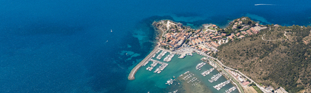 Aerial image of the beautiful town and small port of Talamone at the Tuscany Mediterranean coast in Italy Stok Fotoğraf - 112586630