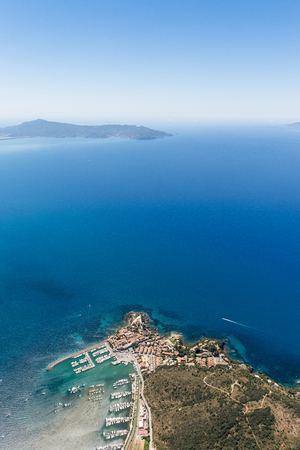 Aerial image of the beautiful town and small port of Talamone at the Tuscany Mediterranean coast in Italy