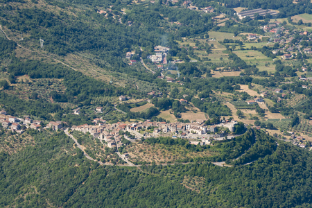 Aerial image of typical village on a hill in the Apennines mountains near Monte Nutria