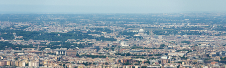 Aerial panoramic image of the city of Rome Roma showing the Vatican with St. Peters Basilica in the centre, but also buildings such as the Colosseum