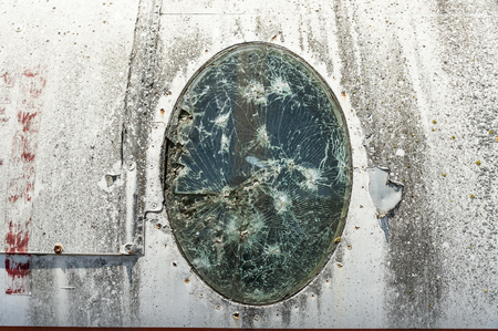 Detail of a broken airplane window