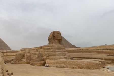 Restauration works on the Great Sphinx of Giza commonly referred to as the Sphinx of Giza or just the Sphinx, is a limestone statue of a reclining sphinx, a mythical creature with the body of a lion and the head of a human. Facing directly from West to East, it stands on the Giza Plateau on the west bank of the Nile in Giza, Egypt. The face of the Sphinx is generally believed to represent the Pharaoh Khafre. 