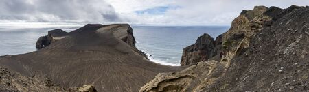 Panorama landscape of the new born land of the Capelinhos volcanic eruption in 1957-1958 at Faial island.