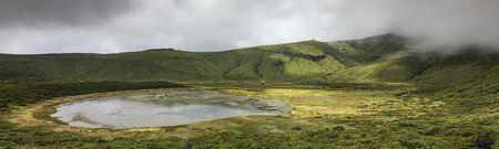 Landscape panorama at Lagoa Branca caldera crater lake on the Azores island of Ilha das Flores, Portugal Stok Fotoğraf