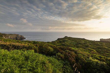 Amazing green landscape at sunrise at the mirador de Alagoa of the Agualva coastline on Terceira, Azores, Portugal