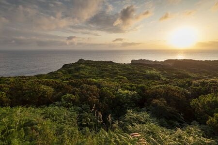 Amazing green landscape at sunrise at the mirador de Alagoa of the Agualva coastline on Terceira, Azores, Portugal