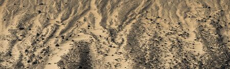 Aerial view from black desert streams down the sides of the volcanic crater of Marsous mountain in the Egyptian western desert.