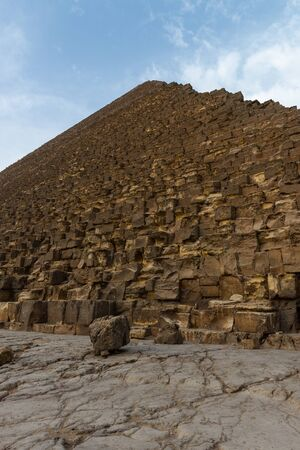 The Great Pyramid of Giza (also known as the Pyramid of Khufu or the Pyramid of Cheops) is the oldest and largest of the three pyramids in the Giza pyramid complex bordering what is now El Giza, Egypt.