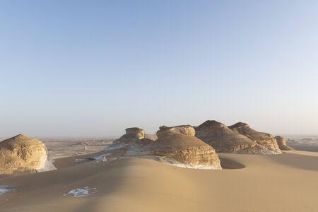 The amazing landscape of the El Aqabat desert before sunset, in the White Desert National Park in Egypt
