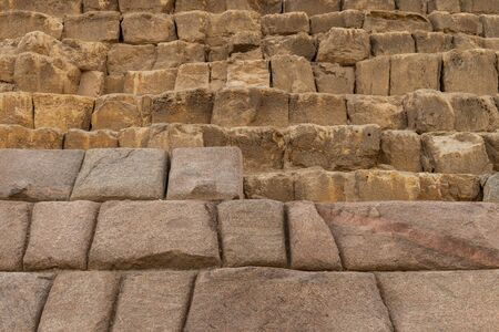 The Pyramid of Menkaure is the smallest of the three main Pyramids of Giza, located on the Giza Plateau in the southwestern outskirts of Cairo, Egypt. It is thought to have been built to serve as the tomb of the fourth dynasty Egyptian Pharaoh Menkaure. The first sixteen courses of the exterior were made of red granite. Imagens