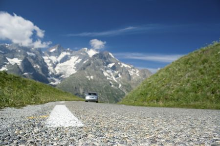 Road, car driving french Alps. France Stock Photo