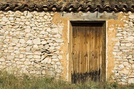 barn door: Old barn house building, stone wall. Stock Photo