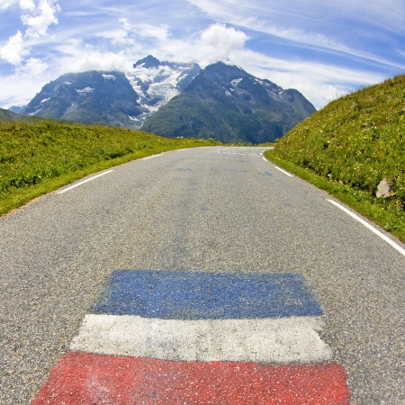 Road in mountain, french alps with french flag. photo