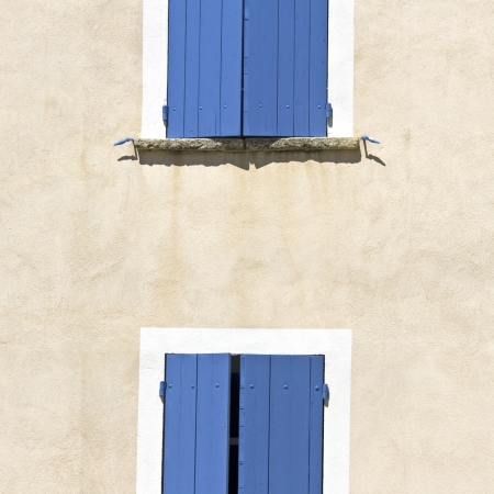 Blue shutter on facade in Provence. France. Stock Photo