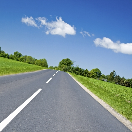 Road in countryside, with sky Stock Photo