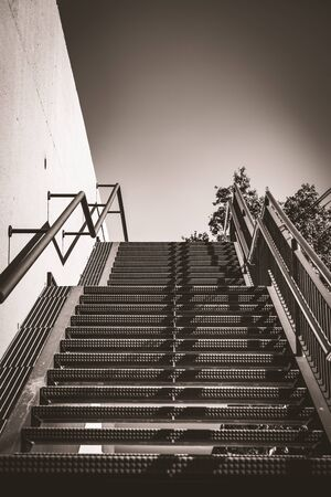 Exterior metal stairs in warm black and white