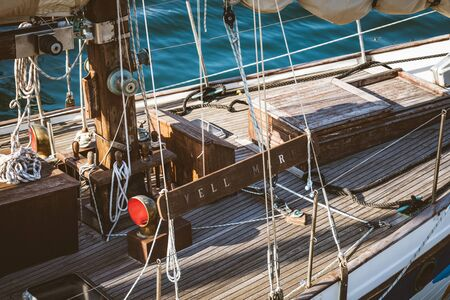 Ropes, mast and deck of an old wooden sailboat