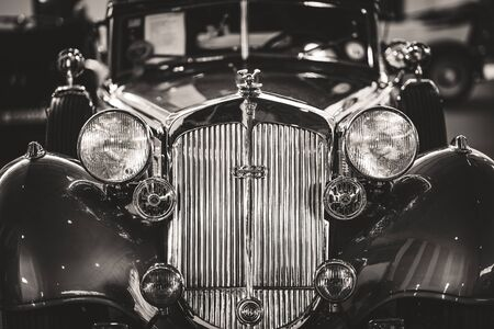 Front details of the grille and headlamps of a cabriolet sports car in black and white Reklamní fotografie