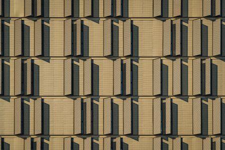 Modern building facade full of window shutters 免版税图像