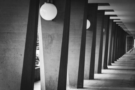 Outdoor hallway with columns in black and white