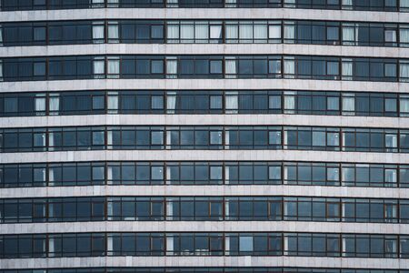 Rows of windows of an urban building creating a pattern