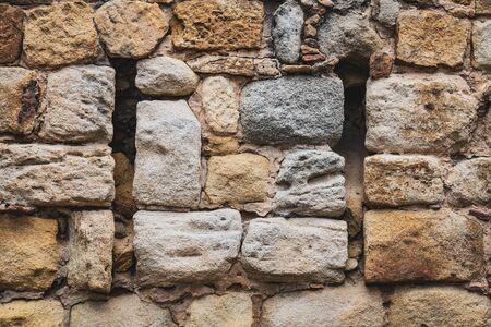 Historical stone wall built with natural calcareous rocks-blocks 写真素材