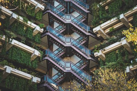 Exterior stairway of an office building covered by hydroponic floating gardens