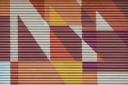 Detail of a graffiti painted by Slomo on a metallic roller shutter Imagens