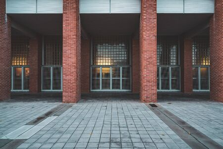 Brick columns and facade of an university building in the afternoon