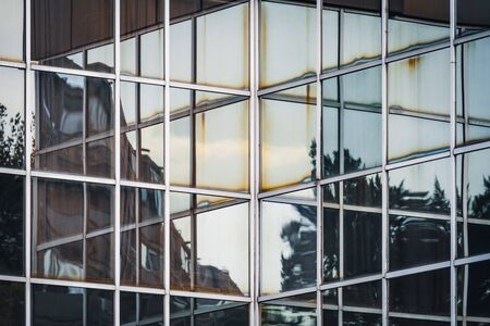 Reflections on the corner of the glass facade of an office building