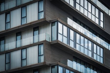 Architecture detail of the glass balconies of a minimalist urban building 免版税图像