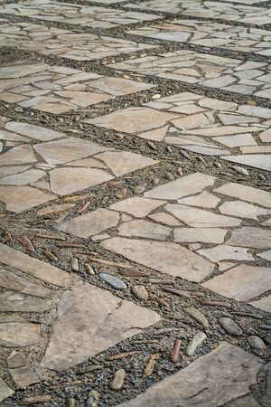 Stone floor decorated with river boulders and natural limestone