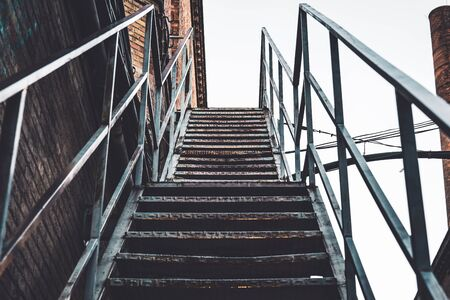 Exterior rusty stairs of an old abandoned textile factory Foto de archivo