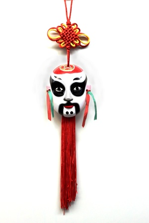 White Korean mask with red and yellow tassels