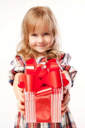 beautifully wrapped: little cute girl giving a gift in a beautifully  wrapped gift box Stock Photo