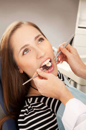 Young woman being examined by a dentist photo