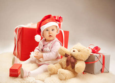 Adorable baby with christmas presents photo