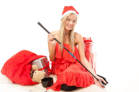 christmas golf: Young attractive blonde woman with presents and a golf club