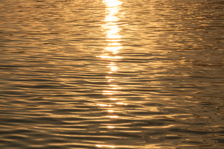 affected: The Sun affected the surface of the water. Stock Photo