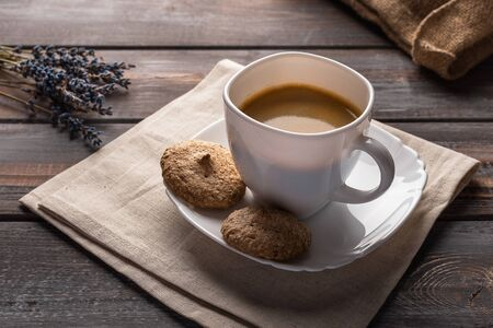Cup of coffee on a linen napkin. Coffee beans and bag Stok Fotoğraf