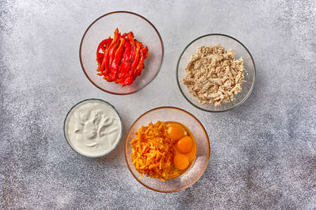 Ingredients - chicken, eggs, cheese, sour cream for homemade quiche pie, top view, copy space