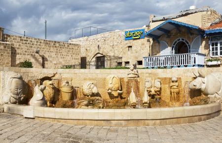 yaffo: TEL AVIV, ISRAEL - NOVEMBER 30, 2015: Fountain of zodiac signs in Jaffa, Tel Aviv, Israel Stock Photo