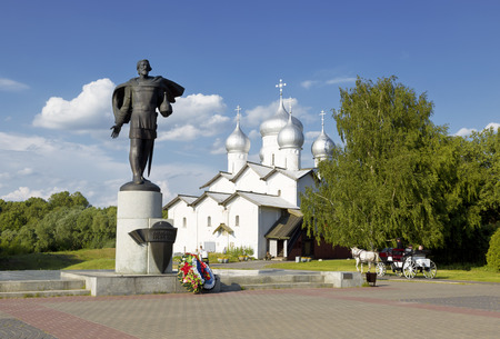 boris: The monument to Russian prince Alexander Nevsky against the Church of Boris and Gleb in the Carpenters, Velikiy Novgorod, Russia Stock Photo