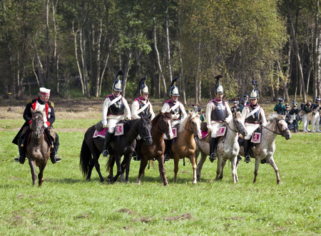 marshal: MOSCOW REGION, RUSSIA - SEPTEMBER 01, 2012: Reenactment of the Borodino battle between Russian and French armies in 1812. Field Marshal Kutuzov and Russian cuirassiers at Borodino Editorial