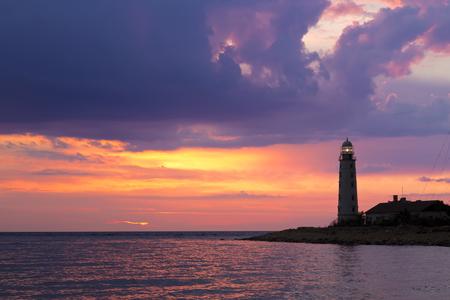 日没、セヴァストポリ、クリミア半島の灯台 写真素材