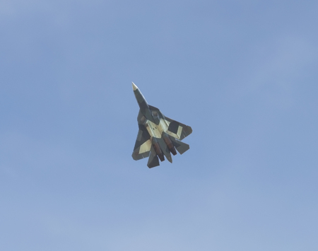 stealth: ZHUKOVSKY, RUSSIA - AUGUST 28, 2015: International aviation and space salon in Zhukovsky. The flight of stealth multirole fighter of the fifth generation Editorial