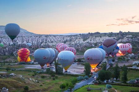 goreme: CAPPADOCIA, TURKEY - JUNE 15, 2015: Preparing the balloon for flight early morning in Cappadocia, Turkey